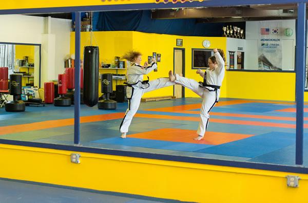 Barbara Hilija Spiessl and her sister, Heidi, practicing Taekwon-Do